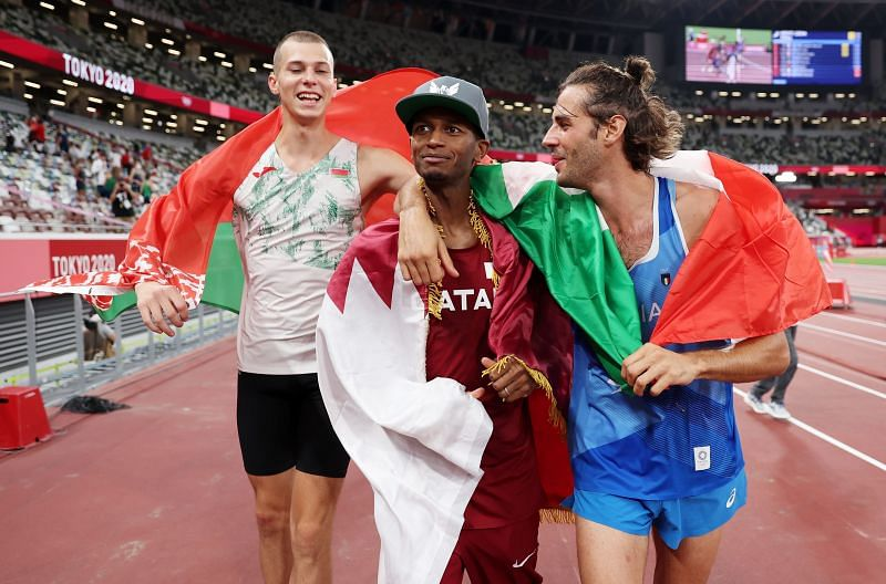 Mutaz Essa Barshim and Gianmarco Tamberi celebrate after winning gold