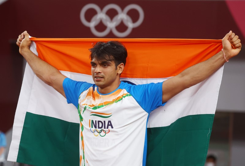 Neeraj Chopra was greeted by fellow members of the Indian contingent after winning the Olympic gold medal